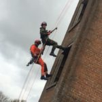 Abseiling down a fire station tower