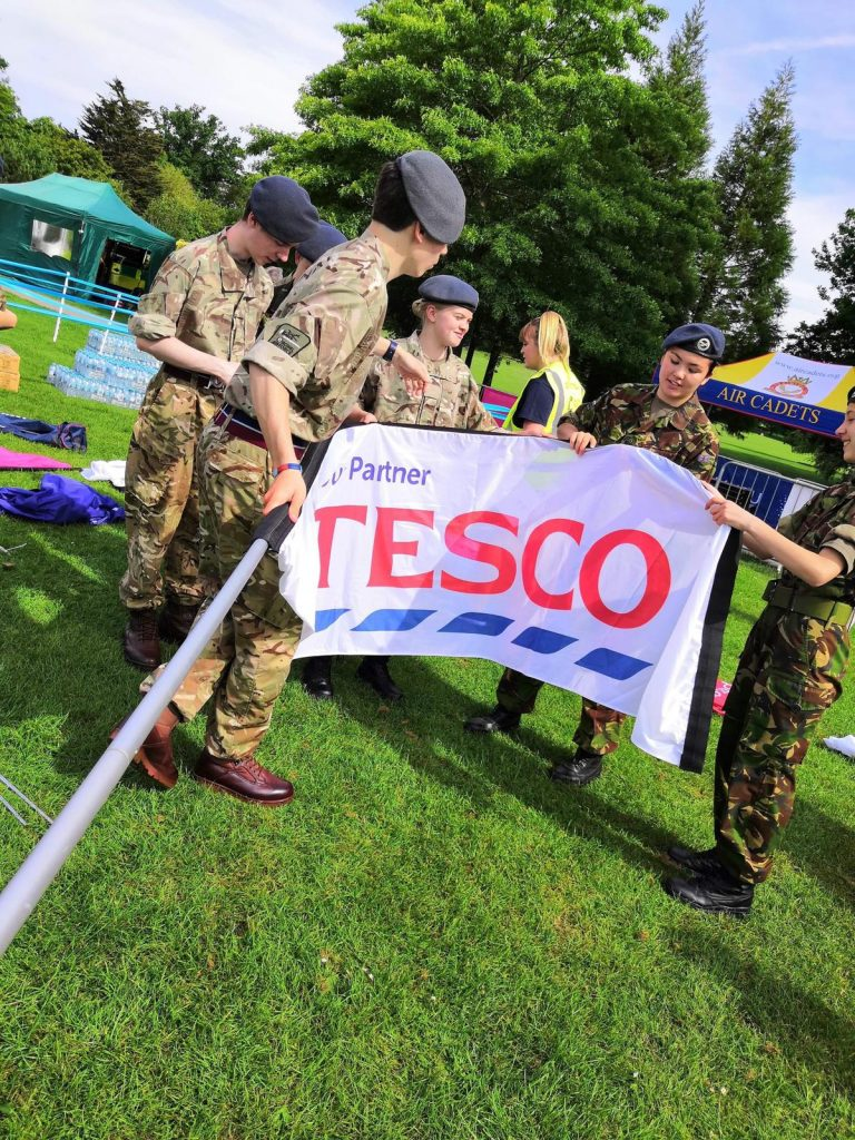 Horsham Air Cadets Race for Life - putting up banners